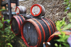 Wooden wine barrel. With red hoops royalty free stock photos
