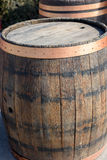 Wooden wine barrel. Wooden open empty wine barrel in the sun royalty free stock photography