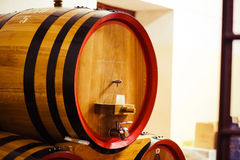 Wooden wine barrel with a tap from a wine-grower Royalty Free Stock Photography