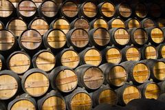 Wooden wine barrels on a cellar. View of a bunch of wooden wine barrels on a cellar Stock Photos