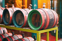 Wooden wine barrels on the market. Old wooden wine barrels on the market Stock Images