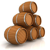 Wooden wine barrels pyramid on white Royalty Free Stock Photos