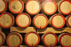 Wooden wine barrels are stored in winery cellar Royalty Free Stock Photography