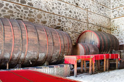 Wooden wine barrels in an underground cellar Royalty Free Stock Images