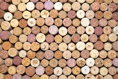 Wooden wine corks. Brown background of wooden wine corks stock photo