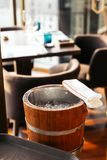Wooden wine ice bucket with white fabric. Prepare for cooling some wines.  stock photography