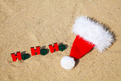 Wooden word 'Ho! Ho! Ho!' with Santa's hat Royalty Free Stock Photos