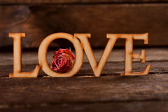 Wooden word LOVE with dried rose Stock Photos