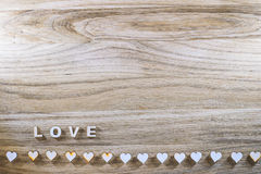 Wooden word love and the heart on a rustic background. Valentine's Day. Royalty Free Stock Images