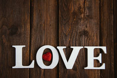 Wooden word love. White wooden word love on brown background Royalty Free Stock Photos
