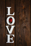 Wooden word love. White wooden word love on brown background Stock Photography