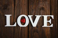 Wooden word love. White wooden word love on brown background Stock Images