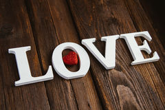 Wooden word love. White wooden word love on brown background Royalty Free Stock Photo