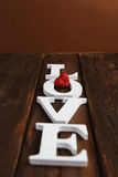 Wooden word love. White wooden word love on brown background Stock Image