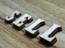 Word sell. Wooden word, & x27;sell& x27; inscription on a wooden background Royalty Free Stock Image