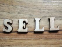 Word sell. Wooden word, & x27;sell& x27; inscription on a wooden background Royalty Free Stock Images