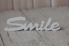 Wooden word smile Stock Image