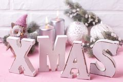 Wooden word Xmas, decorative bird owl, silver candles, branches Stock Image
