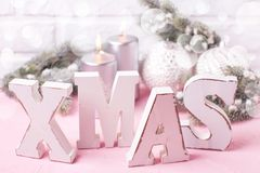 Wooden word Xmas,  silver candles, branches fur tree and balls Stock Images