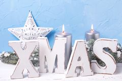 Wooden word Xmas,  silver candles, branches fur tree and star Stock Image