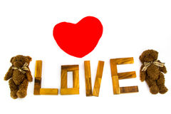 Wooden words `LOVE` made from natural material letters .Valentine background Stock Image