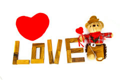Wooden words `LOVE` made from natural material letters .Valentine background Royalty Free Stock Images