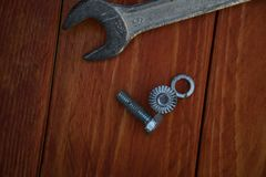 Wrench on the table with bolts and washers royalty free stock photography