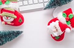Wooden working table with computer keyboard, mouse , christmas s. Wooden working table with computer keyboard, mouse and  christmas socks. View from above with Royalty Free Stock Images