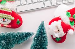 Wooden working table with computer keyboard, mouse , christmas s. Wooden working table with computer keyboard, mouse and  christmas socks. View from above with Royalty Free Stock Image