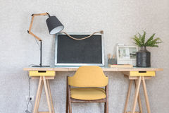 Wooden working table with yellow chair in kid's room Royalty Free Stock Photography