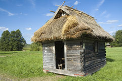 Wooden workshop with thatched roof Stock Photo