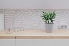 Wooden worktop and modern backsplash. Close up of wooden worktop and modern design backsplash royalty free stock image