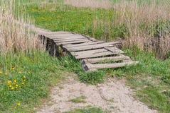 Wooden worn foot-bridge Stock Image