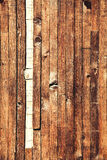 Wooden worn vertical brown planks. Vertical grunge background. Stock Photography