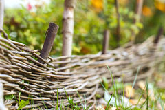 Wooden woven fence Stock Images