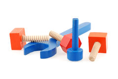 Wooden wrench and screws toys Royalty Free Stock Photo