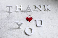 Wooden wthite letter Thank you on the crumpled carpet Royalty Free Stock Photography