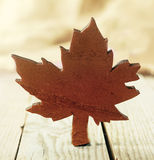 Wooden Xmas maple leaf decoration Royalty Free Stock Photography