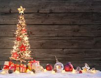 Wooden Xmas Tree With Rustic Baubles Stock Image