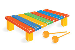 Wooden xylophone with mallet Royalty Free Stock Image