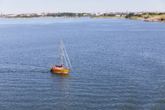 Wooden yacht in calm blue sea. Wooden yacht or sail boat on calm blue sea Royalty Free Stock Images