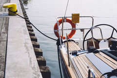 Wooden yacht docked at pier. Wooden yacht docked at Sopot Pier, Baltic Sea Royalty Free Stock Images