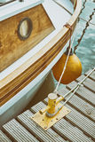 Wooden yacht moored to bollard in marina. Stock Images