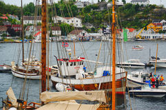 Wooden yachts with high masts moored at the marina Stock Image
