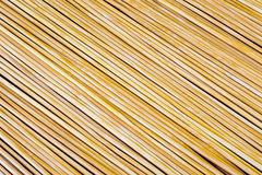 Wooden yellow bamboo mat texture abstract background. Royalty Free Stock Photo