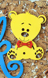 Wooden yellow bear toy. For baby Royalty Free Stock Photo
