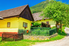 Wooden yellow hut and street in Vlkolinec Slovakia Stock Photography