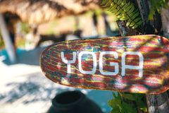 Wooden yoga sign royalty free stock photography