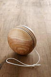 Wooden Yoyo. An old fashioned style wooden yoyo a retro childhood concept Stock Photo