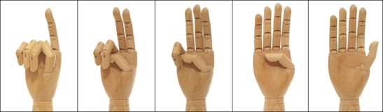 Woodenhand collage: to count. A collage with counting wooden hand Stock Image